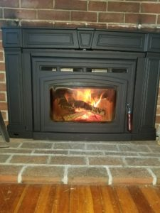 fireplace surrounded by brick wall