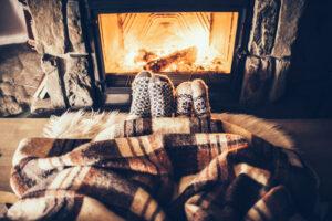 feet next to a fireplace