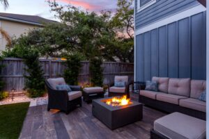 outdoor natural gas fire pit surrounded by furniture
